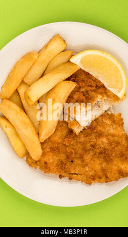 Traditional Popular Fish And Chips Against A Green Background - Stock Photo