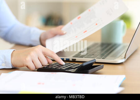 Close up of an accountant hands calculating with a calculator on a desk - Stock Photo
