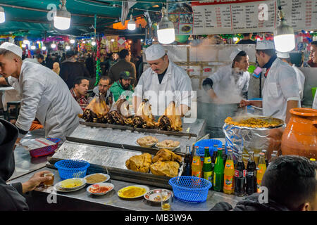 MOROCCO MARRAKECH JEMAA EL FNA MEDINA SOUK EVENING IN THE SQUARE STALLS SELLING A VARIETY OF COOKED FOODS WHERE YOU CAN SIT AND EAT COOKED SHEEP HEADS - Stock Photo
