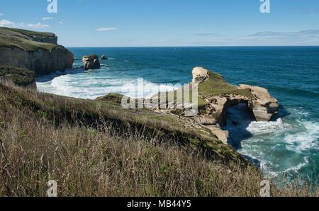 Dramatic Tunnel Beach, Dunedin, New Zealand - Stock Photo
