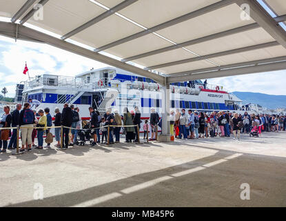 Queue of people waiting at passport control, entering Greece from Turkey, Kos, Greece - Stock Photo
