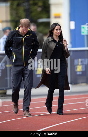 6th April 2018 Bath UK Britain's Prince Harry, Patron of the Invictus Games Foundation, and Meghan Markle attend the UK team trials for the Invictus Games Sydney 2018 at the University of Bath Sports Training Village on Friday 6th April. Prince Harry and Meghan Markle joined Invictus Games hopefuls as they try out on the athletics track and field, before meeting those taking part in the indoor sitting volleyball trials. - Stock Photo