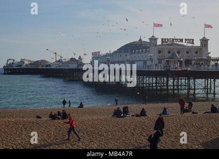 Brighton Beach, UK. 6th Apr, 2018. UK Weather: People enjoy the warm weather on Brighton Beach as children enjoy their Easter Holidays with parts of Britain seeing what is the hottest day of the year so far. Credit: Lauren Hurley/Alamy Live News - Stock Photo