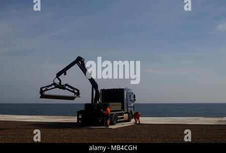"Brighton, UK. 6th April 2018. Workmen install boards on Brighton Beach in East Sussex in preparation for the World Cup where the football will be televised live for the public to enjoy. Tourists and locals can enjoy the first England match on Monday 18th June from the beach. The big screen area run by Luna Beach Cinema will also be used to screen blockbusters on 'the highest definition LED screen in the country."" Credit: Lauren Hurley/Alamy Live News Credit: Lauren Hurley/Alamy Live News - Stock Photo"
