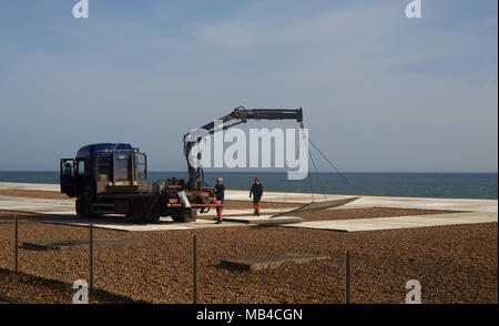 """Brighton, UK. 6th April 2018. Workmen install boards on Brighton Beach in East Sussex in preparation for the World Cup where the football will be televised live for the public to enjoy. Tourists and locals can enjoy the first England match on Monday 18th June from the beach. The big screen area run by Luna Beach Cinema will also be used to screen blockbusters on 'the highest definition LED screen in the country."""" Credit: Lauren Hurley/Alamy Live News Credit: Lauren Hurley/Alamy Live News - Stock Photo"""