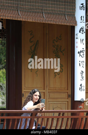 Los Angeles, USA. 6th Apr, 2018. A visitor takes photos in the Chinese Garden at the Huntington Library, Art Collections and Botanical Gardens in Los Angeles, the United States, April 6, 2018. Credit: Li Ying/Xinhua/Alamy Live News - Stock Photo