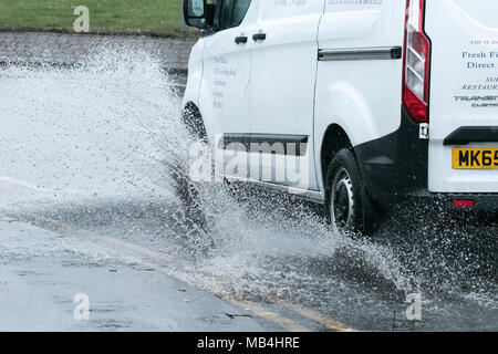 Southport, Merseyside. 7th April 2018.  UK Weather.  April showers rain down causing localised flooding to build up along the main coastal road between Southport and Liverpool.  Cars and vans splashed their way through the huge puddles as the traffic queues built up behind.  Credit: Cernan Elias/Alamy Live News - Stock Photo