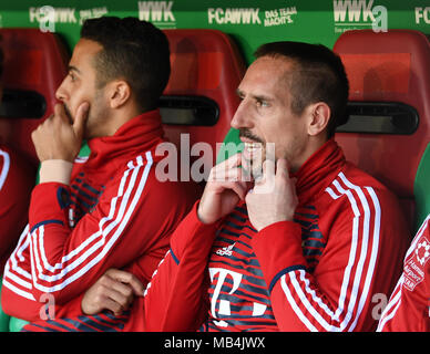 Augsburg, Germany. 7th April 2018. Soccer: Bundesliga, FC Augsburg vs FC Bayern Munich, in the WWK Arena. Bayern Munich's Thiago Alcantara (left to right) and Franck Ribery sitting on the bench. Photo: Sven Hoppe/dpa - IMPORTANT NOTICE: Due to the German Football League·s (DFL) accreditation regulations, publication and redistribution online and in online media is limited during the match to fifteen images per match Credit: dpa picture alliance/Alamy Live News Credit: dpa picture alliance/Alamy Live News Credit: dpa picture alliance/Alamy Live News Credit: dpa picture alliance/Alamy Live News  - Stock Photo