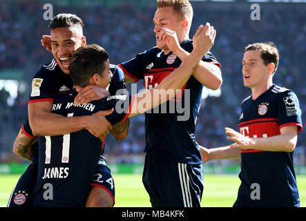 Augsburg, Germany. 7th April 2018.  Soccer: Bundesliga, FC Augsburg vs FC Bayern Munich, in the WWK Arena. Munich's Corentin Tolisso (L-R) celebrating with team mates James Rodriguez, Joshua Kimmich and Sebastian Rudy the goal that made it 1:1. Photo: Sven Hoppe/dpa Credit: dpa picture alliance/Alamy Live News - Stock Photo