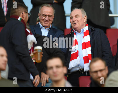 Augsburg, Germany. 7th April 2018.  Soccer: Bundesliga, FC Augsburg vs FC Bayern Munich, in the WWK Arena. Munich's chairman Karl-Heinz Rummenigge (L) and president Uli Hoeness sitting in the stands. Photo: Andreas Gebert/dpa Credit: dpa picture alliance/Alamy Live News - Stock Photo