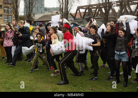 London, UK. 7th Apr, 2018. People have fun taking part in the International Pillow Fight Day 2018 in London, Britain on April 7, 2018. Credit: Ray Tang/Xinhua/Alamy Live News - Stock Photo