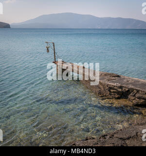 Jetty made of concrete in a cove near Ustrine, Cres Croatia, on a sunny day in spring - Stock Photo