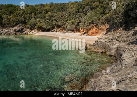 Small cove near Ustrine (Cres, Croatia) on a sunny day in spring - Stock Photo