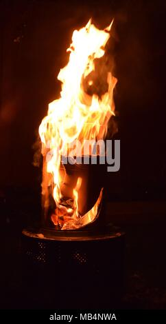Burning cardboard in a Chimiea - Stock Photo