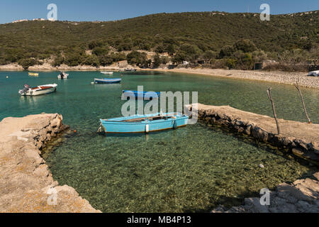 Cove near Ustrine (Cres, Croatia) with small fishing boats on a sunny day in spring - Stock Photo