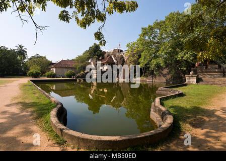 Horizontal view across Isurumuniya temple in Anuradhapura, Sri Lanka. - Stock Photo
