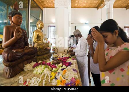 Horizontal portrait of people praying at the altar in Jaya Sri Maha Bodhi in Anuradhapura, Sri Lanka. - Stock Photo