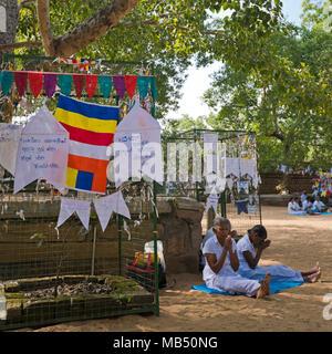 Square close up of people praying at the Bodhi tree at Jaya Sri Maha Bodhi in Anuradhapura, Sri Lanka. - Stock Photo