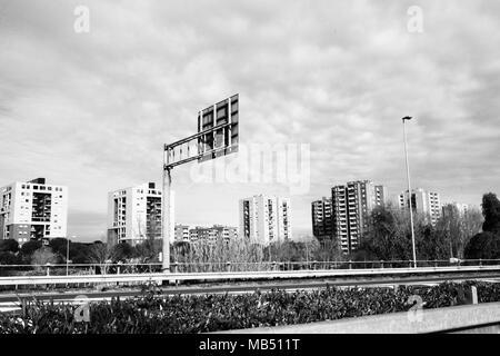 Road to Torbellamonaca housing project buildings, Rome, Italy - Stock Photo