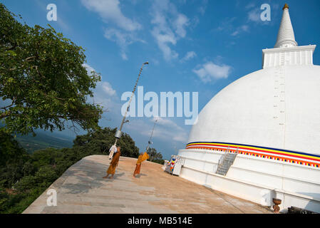 Horizontal view of the huge Maha Stupa or dagoba at Mihintale mountain, Sri Lanka. - Stock Photo