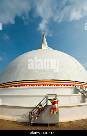 Vertical view of the huge Maha Stupa or dagoba at Mihintale mountain, Sri Lanka. - Stock Photo