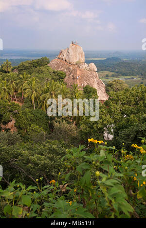 Vertical view of the pilgrimage site Aradhana Gala rock at Mihintale mountain, Sri Lanka. - Stock Photo