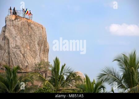 Horizontal view of the pilgrimage site Aradhana Gala rock at Mihintale mountain, Sri Lanka. - Stock Photo