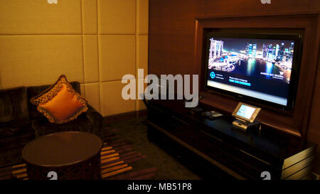 SINGAPORE - APR 2nd 2015: In-Home Theater in Luxury Hotel Room. - Stock Photo