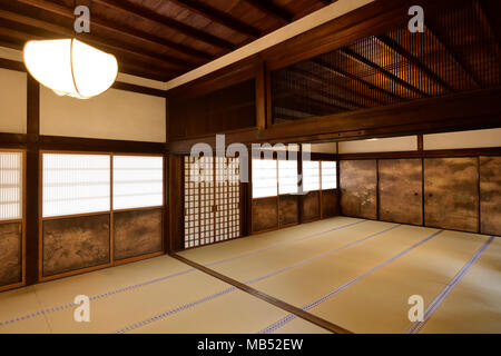 Traditional Japanese interior with tatami mats and painted shoji sliding screens in Sanbo-in, Sanboin Buddhist temple - Stock Photo