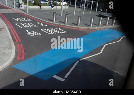 A blue strip awaiting stencilled lettering stretches across the junction at the south side of Westminster Bridge, on 6th April 2018, in London, England. - Stock Photo