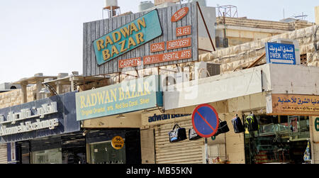 Aqaba, Jordan, March 8, 2018: Signs at shops and signs for tourists in downtown Aqaba, for purchase of silver, coral, embrodery, carpets and oriental  - Stock Photo