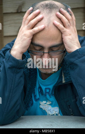 depressed man thinks there is no way out - Stock Photo