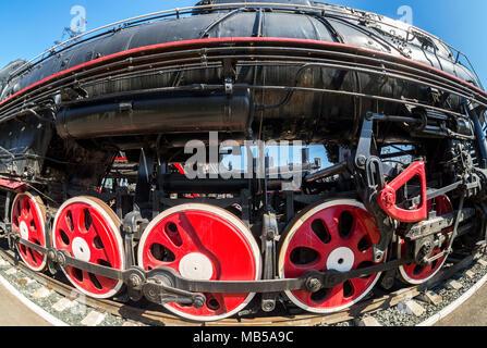 Vintage steam locomotive engine wheels and rods details. Retro steam locomotive - Stock Photo