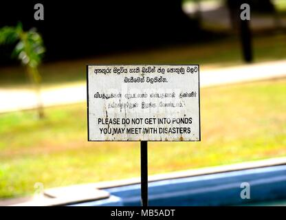Colombo, Sri Lanka - January 2017 - Warning sign in three languages - Stock Photo