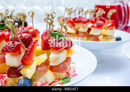Set of delicious canapes with strawberry, pineapple, pear, blueberries and grape - Stock Photo