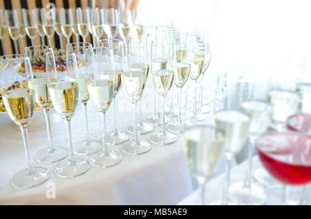 Champagne in the glases on the buffet table - Stock Photo