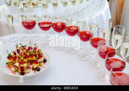 Champagne in the glases on the buffet table. Canapes with strawberry - Stock Photo