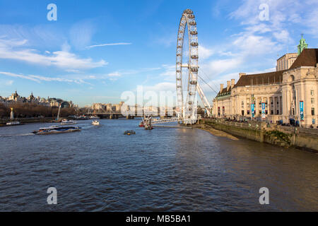 London Eye and the River Thames against a blue sky with white whispy clouds - London, England - UK - Stock Photo