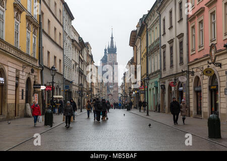 View looking down Ulica Florianska with St. Mary's Basilica in background - Krakow, Poland - Stock Photo
