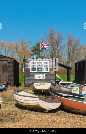 Beach UK, view of boats and fishermens' huts on the beach at Orford  Suffolk, East Anglia, England, UK.