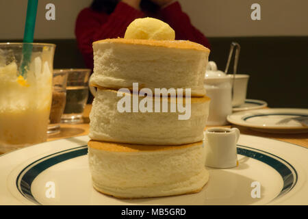 3 fluffy pancakes stacked from the famous Gram Cafe and Pancakes in Japan - Stock Photo