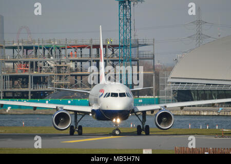 British Airways Airbus 318 aircraft taxiing at London City Airport - Stock Photo