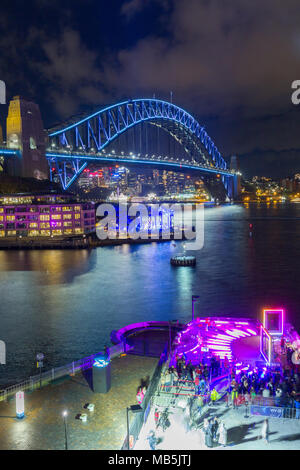 The 'Vivid Sydney' Festival takes place on Sydney Harbour in Sydney, Australia. The popular annual event, held on the shores of Sydney Harbour and previously known as the Vivid Festival, runs from May 26 to June 17, 2017. Pictured: Sydney Harbour Bridge seen from Campbell's Cove. - Stock Photo