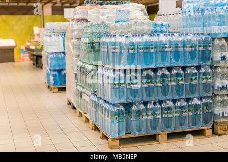 Kiev, Ukraine. February 1 2018. Various choice of plastic mineral water bottles display on the supermarket shelves. - Stock Photo