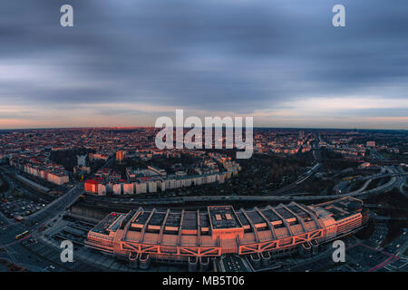 View from the Funkturm. Last rays of pinkish sunlight partially illuminating the higher portion of Berlin buildings, during the final stage of sunset. - Stock Photo