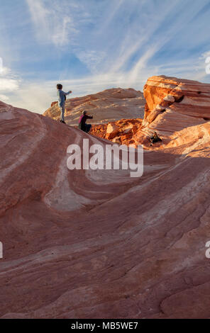 Visitors were taking pictures at the Wave Rock in the Valley of Fire State Park, Nevada, United States. - Stock Photo