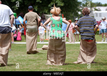 Several unidentified people compete in a sack race at the GREAT festival celebrating Great Britain and the UK, on May 25, 2013 in Atlanta, GA. - Stock Photo