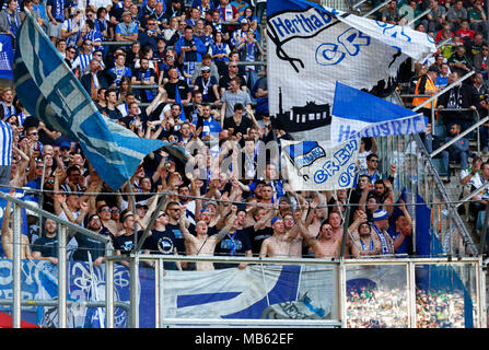 sports, football, Bundesliga, 2017/2018, Borussia Moenchengladbach vs Hertha BSC Berlin 2:1, Stadium Borussia Park, Berlin football fans on the stand waving the club flags - Stock Photo