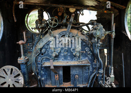 Steam locomotive cab controls and firebox of State Saw Mills steam engine SSM No. 2, slowly rusting away in a rail museum in Pemberton, Western Austra - Stock Photo