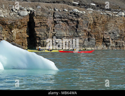 Kayaking in the arctic waters of Spitsbergen on the Svalbard Archipelago in the far north of Norway. - Stock Photo